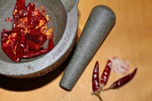 Crush the dried chillies